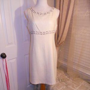 mid length sleeveless cream dress with beading